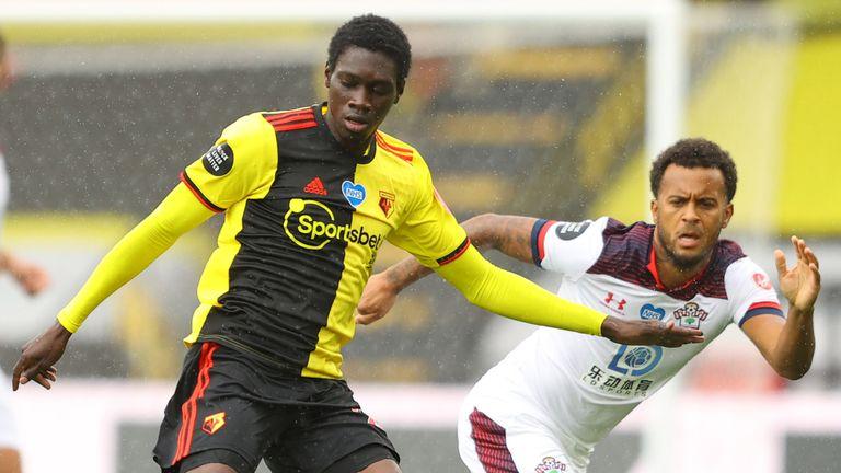 Ismaila Sarr shields the ball from Southampton defender Ryan Bertrand