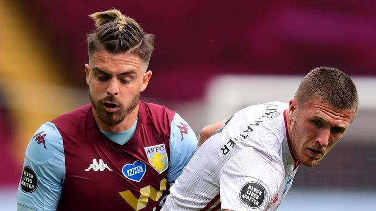 Aston Villa's Jack Grealish and Sheffield United's John Lundstram battle for the ball