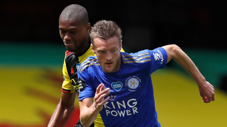 Leicester's Jamie Vardy is challenged by Watford's Christian Kabasele