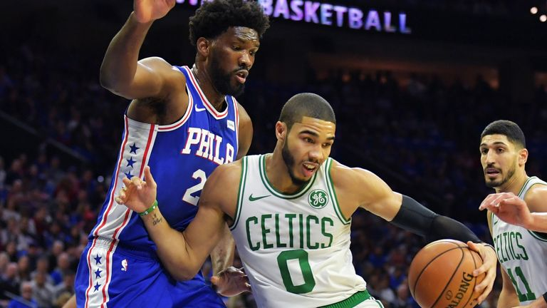 Joel Embiid hounds Jayson Tatum during a 76ers-Celtics game