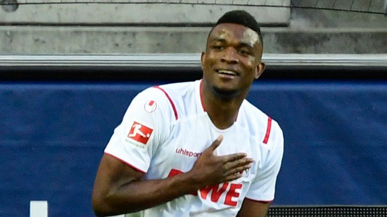 Jhon Cordoba celebrates breaking the deadlock against RB Leipzig