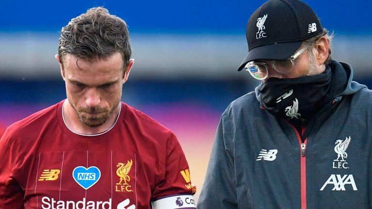 Jurgen Klopp talks to Jordan Henderson after the Merseyside derby on Sunday