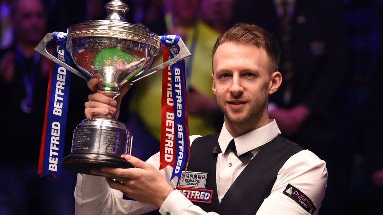 "Reigning champion Judd Trump admits he would defend his world title ""in a car park"" as a behind-closed-doors World Championship draws closer"