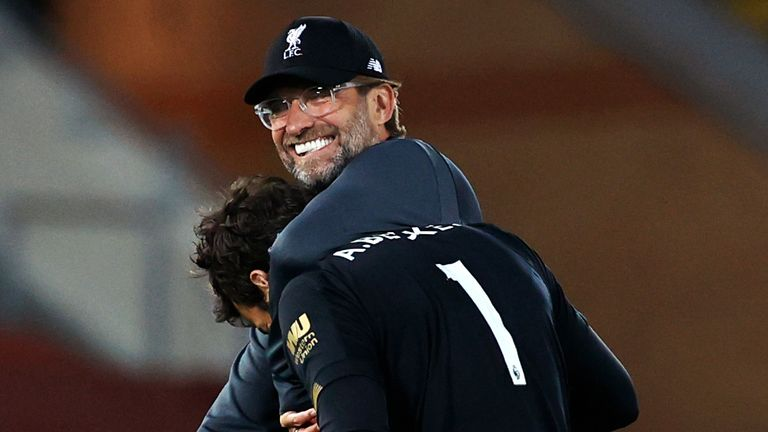 Liverpool manager Jurgen Klopp celebrates victory over Crystal Palace with goalkeeper Alisson