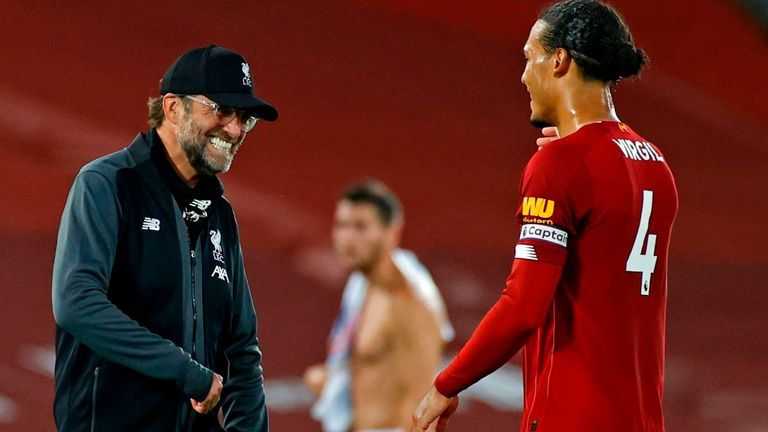 Liverpool's Jurgen Klopp and Virgil van Dijk react after victory over Crystal Palace put them on the brink of glory