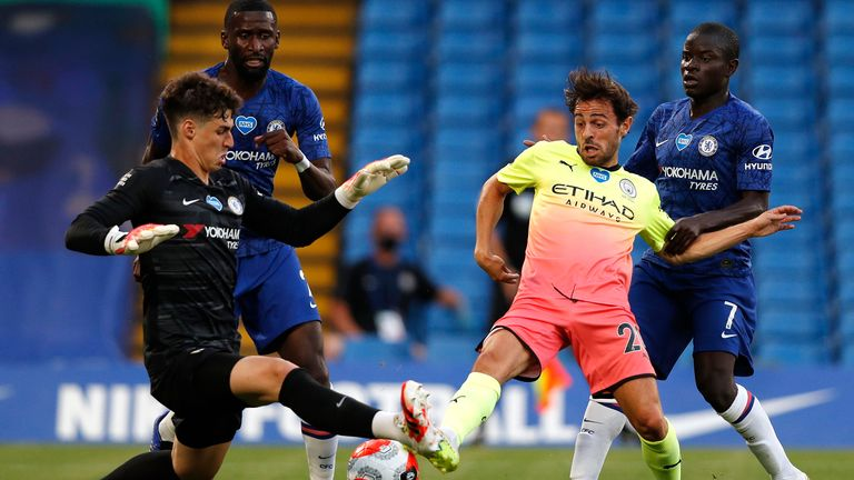 Kepa Arrizabalaga of Chelsea dispossesses Bernardo Silva of Manchester City
