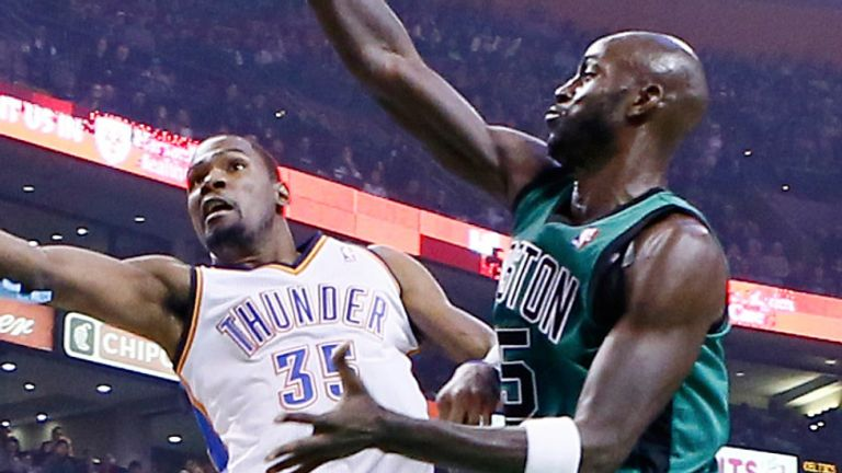 Kevin Garnett challenges Kevin Durant's shot during a 2012 Thunder-Celtics game