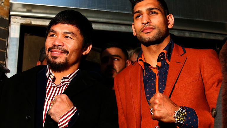 Manny Pacquiao and Amir Khan pose after holding discussions about the possibility of a future fight, at Fitzroy Lodge Amateur Boxing Club on January 23, 2015 in London, England.