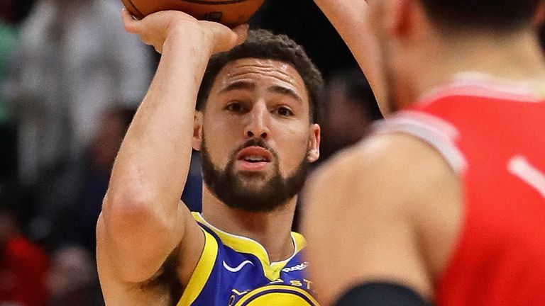 Klay Thompson launches a three-pointer against the Chicago Bulls