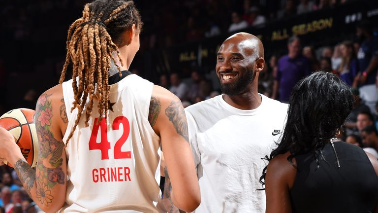 Kobe Bryant shares a joke with Brittney Griner at the 2019 WNBA All-Star Game