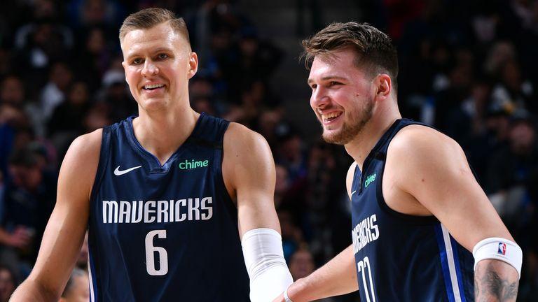 Kristaps Porzingis and Luka Doncic celebrate a basket during a Dallas Mavericks game