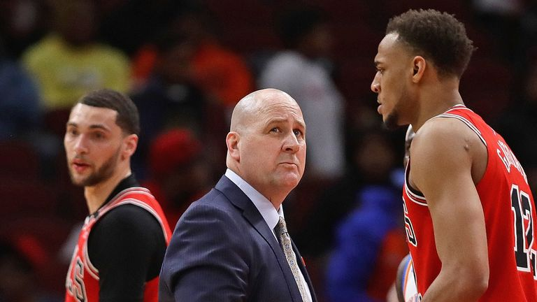 Head coach Jim Boylen of the Chicago Bulls looks up at the clock as Zach LaVine and Daniel Gafford walk off the court