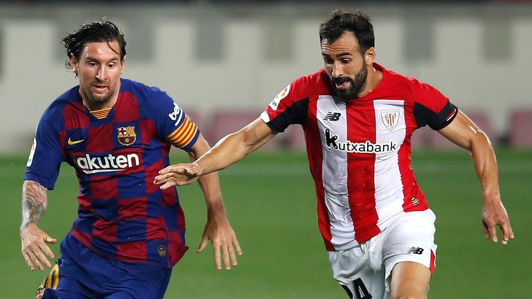 Lionel Messi and Athletic Bilbao's Mikel Balenziaga battle for possession