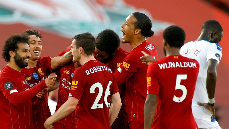 Liverpool celebrate the 4-0 rout that outs them on the brink of glory