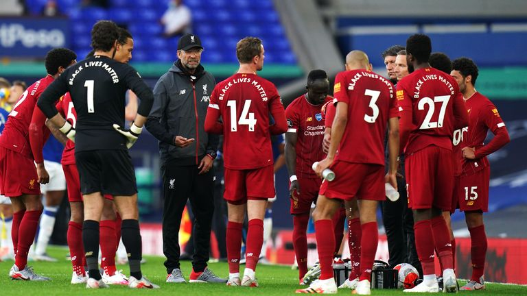 Klopp uses the drinks break to speak to his players during the Merseyside derby last month