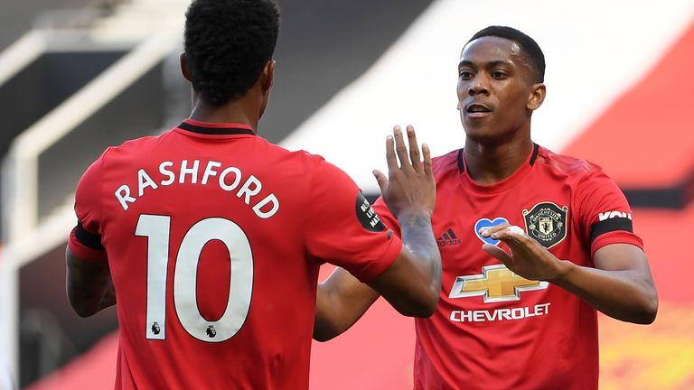 Marcus Rashford celebrates with Anthony Martial