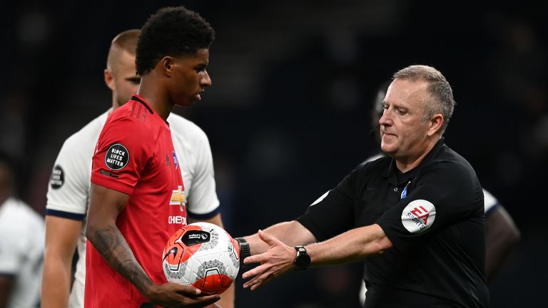 Joss Moss overturned his decision to award Manchester United a second penalty