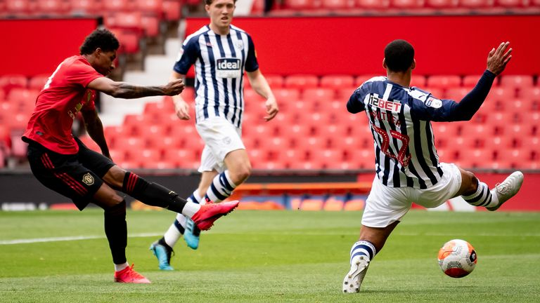 Marcus Rashford shoots during the first friendly game with West Brom