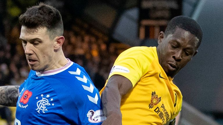 Marvin Bartley (right) challenges Rangers' Ryan Jack