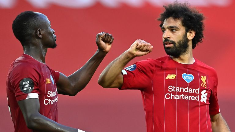 Mohamed Salah celebrates with Sadio Mane after scoring Liverpool's second goal against Crystal Palace
