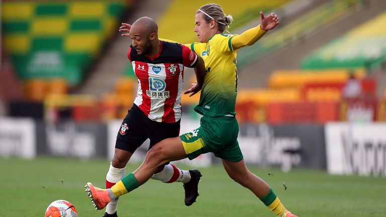 Southampton's Nathan Redmond (left) and Norwich City's Todd Cantwell battle for the ball