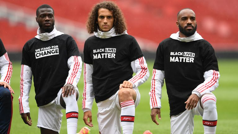 Nicolas Pepe, Matteo Guendouzi and Alexandre Lacazette of Arsenal take a knee in support of Black Lives Matter before the friendly match against Brentford