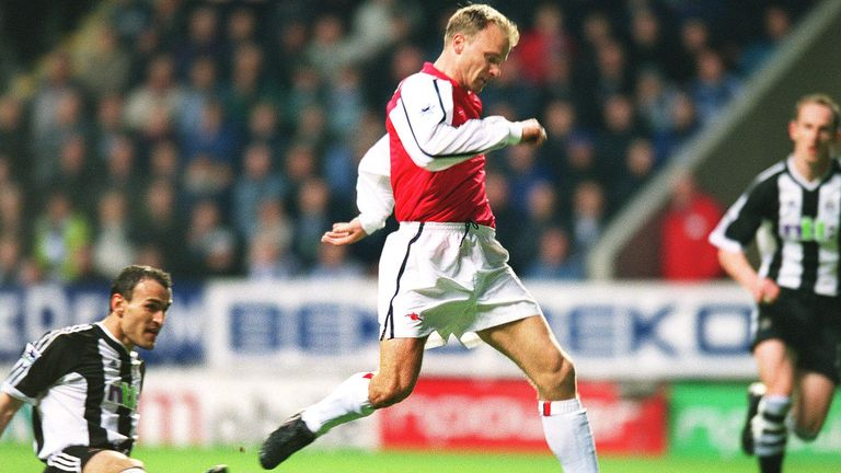 Dabizas is beaten as Bergkamp composes himself to fire at goal