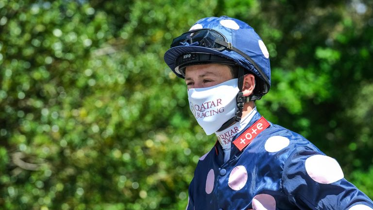 Jockey, Oisin Murphy wears a Qatar Racing face mask at Lingfield Park on June 05, 2020 in Lingfield, England.