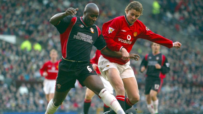 Williams shields the ball from Manchester United's Ole Gunnar Solskjaer