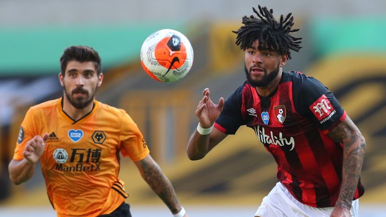 Philip Billing of AFC Bournemouth battles for possession with Ruben Neves of Wolverhampton Wanderers