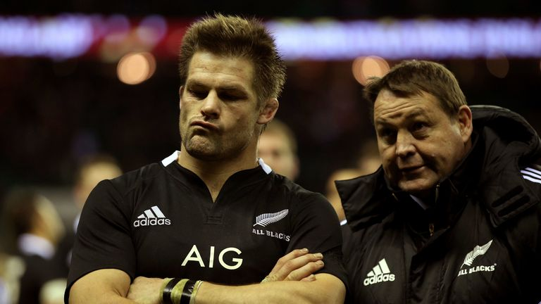 Richie McCaw and Steve Hansen look on after defeat to England