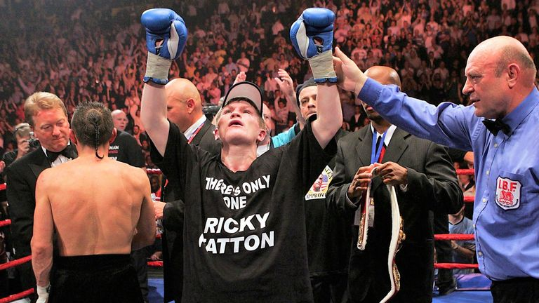 The hometown hero celebrates his IBF title win in Manchester
