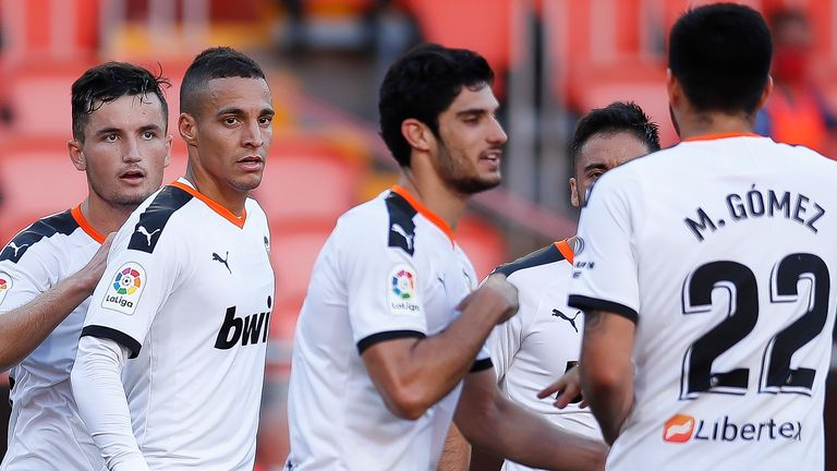 Goncalo Guedes (centre) scored and assisted Valencia's two goals on Sunday