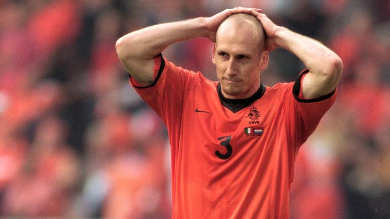 Stam after missing his penalty v Italy in the shootout.