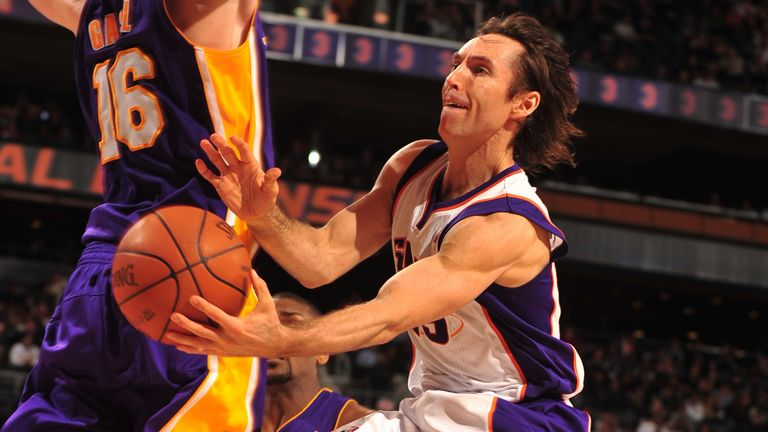 Steve Nash goes airborne to throw a wraparound pass against the Lakers