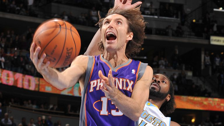 Steve Nash attacks the basket against the Denver Nuggets