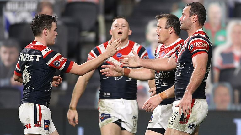 The Roosters celebrate a try in their win over the Eels