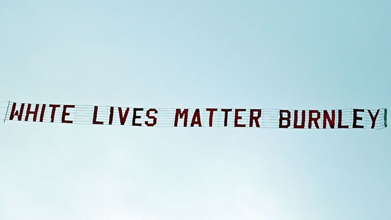 A banner reading 'White Lives Matter Burnley' is towed by a plane above the stadium during the English Premier League football match between Manchester City and Burnley at the Etihad Stadium in Manchester