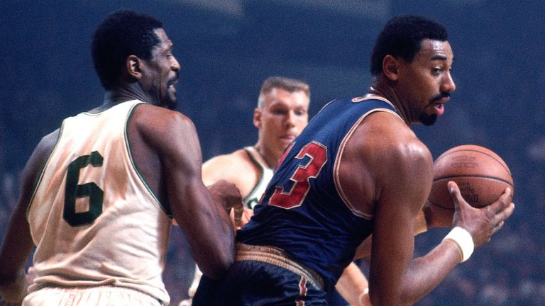 Wilt Chamberlain posts up against arch-rival Bill Russell