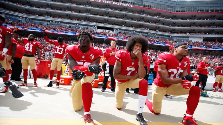 Kaepernick (centre) has not played in the NFL since 2016 when he gained widespread attention for 'taking a knee'