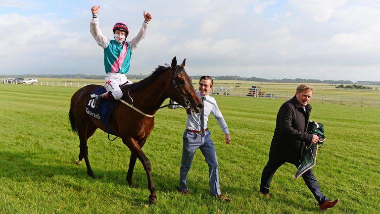 Colin Keane celebrates on Siskin after winning the Irish 2,000 Guineas