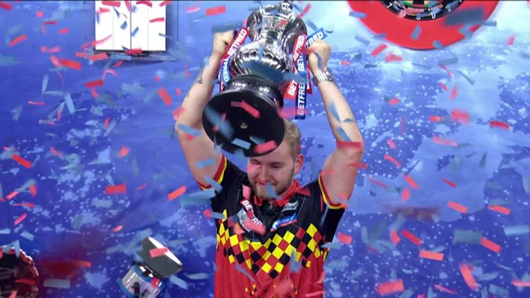 Dimitri Van den Bergh lifts the Phil Taylor trophy after being crowned World Matchplay champion.