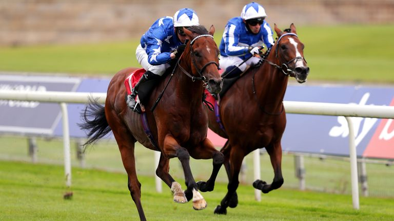 Aspetar ridden by jockey Jason Watson (left) on their way to winning the Sky Bet York Stakes at York Racecourse. PA Photo. Picture date: Saturday July 25, 2020. See PA story RACING Ripon. Photo credit should read: David Davies/PA Wire. RESTRICTIONS: Editorial use only, No commercial use.