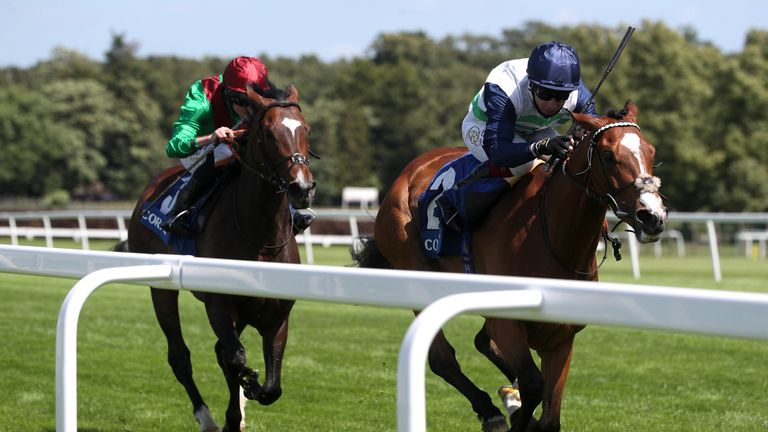 Dashing Willoughby ridden by Oisin Murphy (right) wins the Coral Henry II Stakes at Sandown Park