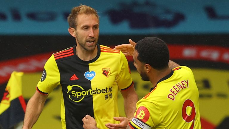 Craig Dawson and Troy Deeney celebrate Watford's opening goal against Norwich.