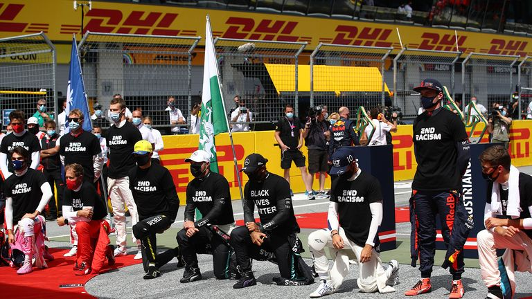Drives take part in an anti-racism protest in support of the Black Lives matter movement prior to the Formula One Styrian Grand Prix race on July 12, 2020 in Spielberg, Austria.
