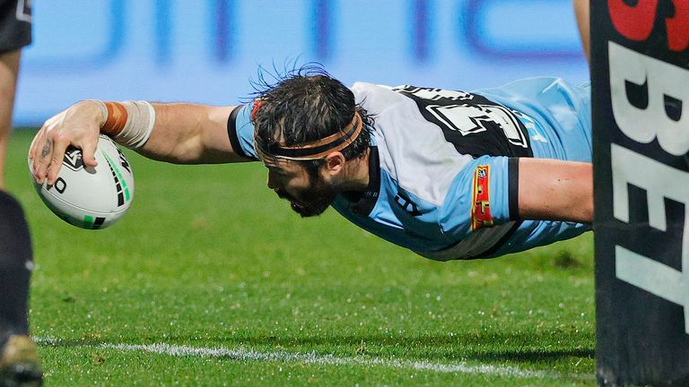 Aaron Woods goes over for a try for the Sharks
