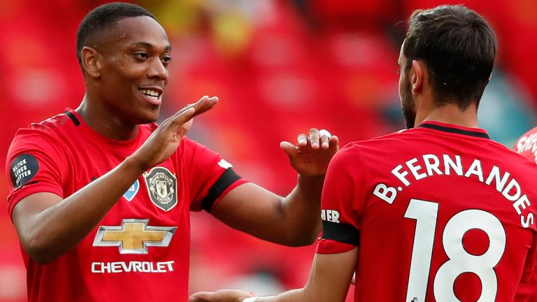 Anthony Martial celebrates with Bruno Fernandes after scoring Manchester United's second goal against Southampton