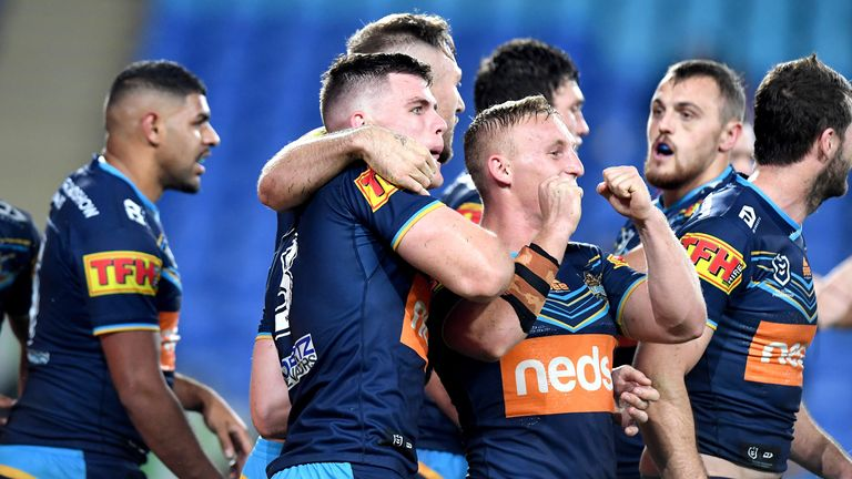 Beau Fermor celebrates his try with his Gold Coast team-mates