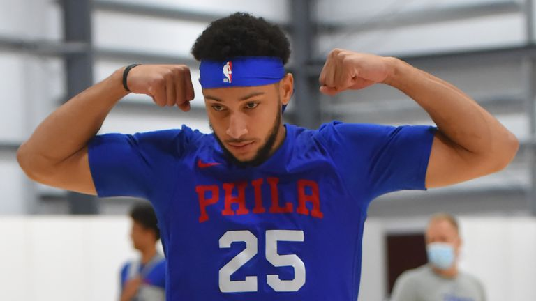 Ben Simmons flexes during the Philadelphia 76ers' first team workout inside the Orlando bubble